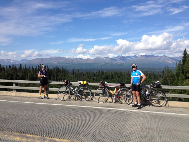 Big Wild Ride Day 3. My riding partners for the day Debra Banks and Drew Carlson.  The Alaska Range on the Parks Highway.